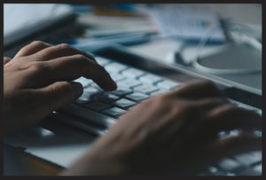 Web Design Barnegat, Close-up of hands on a keyboard