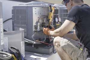 HVAC repair in Manasquan being done by technician